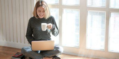 woman-in-gray-sweater-drinking-coffee-3759089